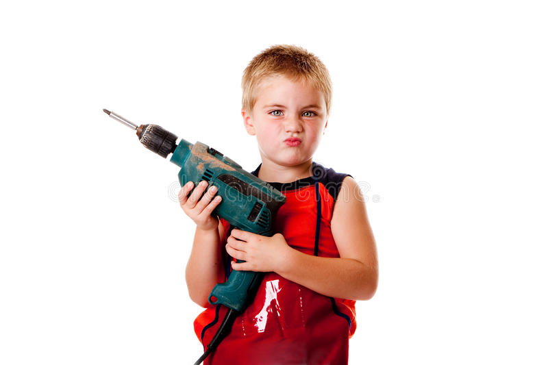 Boy kid with drill stock image