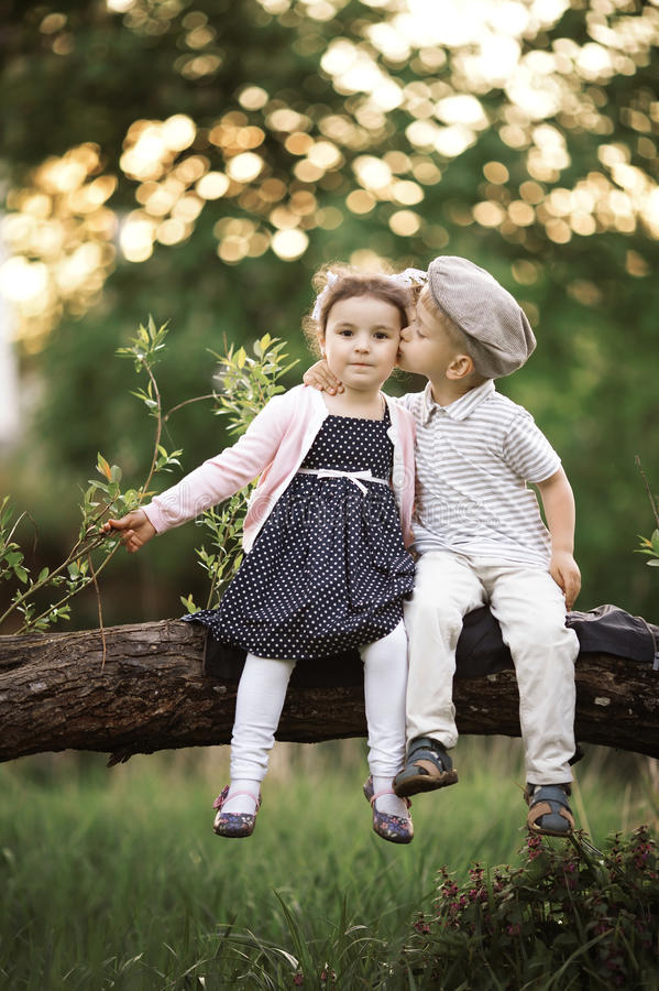 Download Boy kissing a girl stock photo. Image of love, dress - 28951640