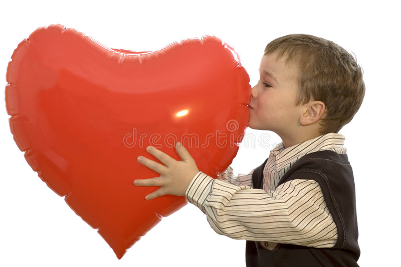 Boy Kissing Heart. A Lovely picture of a 5-year old boy kissing a heart. Use it for all kinds of love and child pictures! On white background