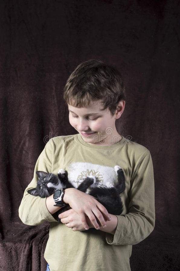 Boy with a kitten royalty free stock photography