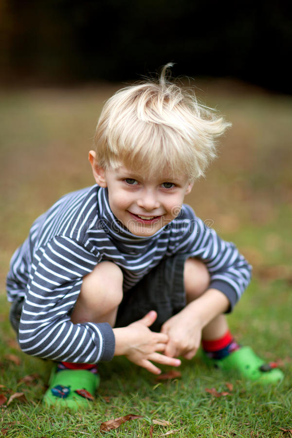 Boy kneeling royalty free stock photo
