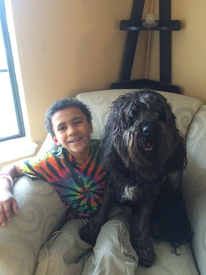 Boy and labradoodle royalty free stock photography