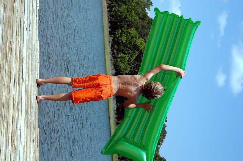 Boy at lake royalty free stock photography