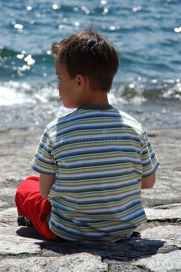 Download Boy at lake side stock image. Image of summer, water, vacation - 239885