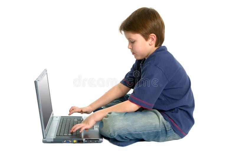 Boy on a laptop stock image