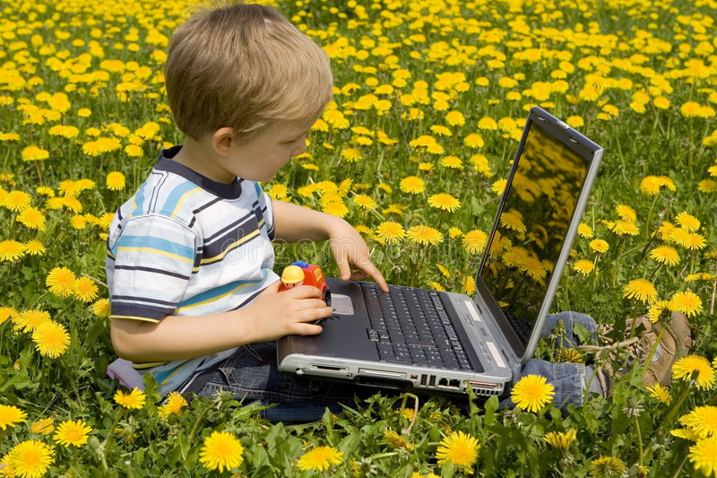 Boy with laptop stock image