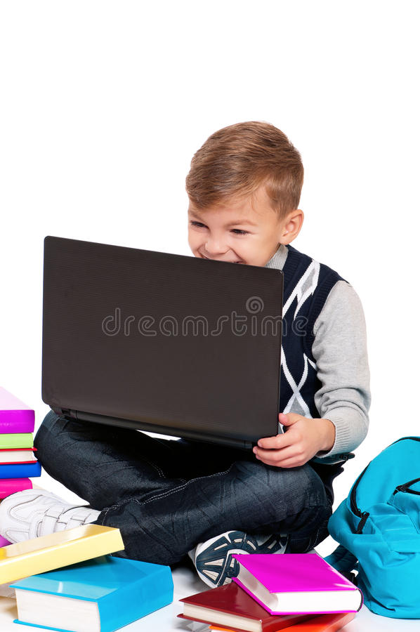 Boy With Laptop And Books Stock Photo