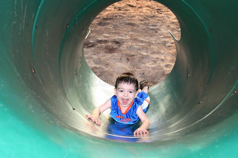 Download Boy Laughing And Playing With The Slide Stock Photo - Image: 167446