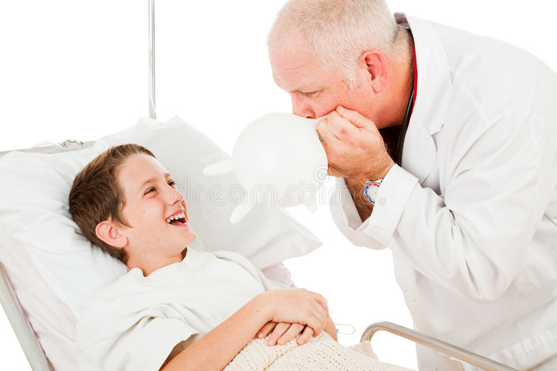 Boy Laughs at Doctor stock photo
