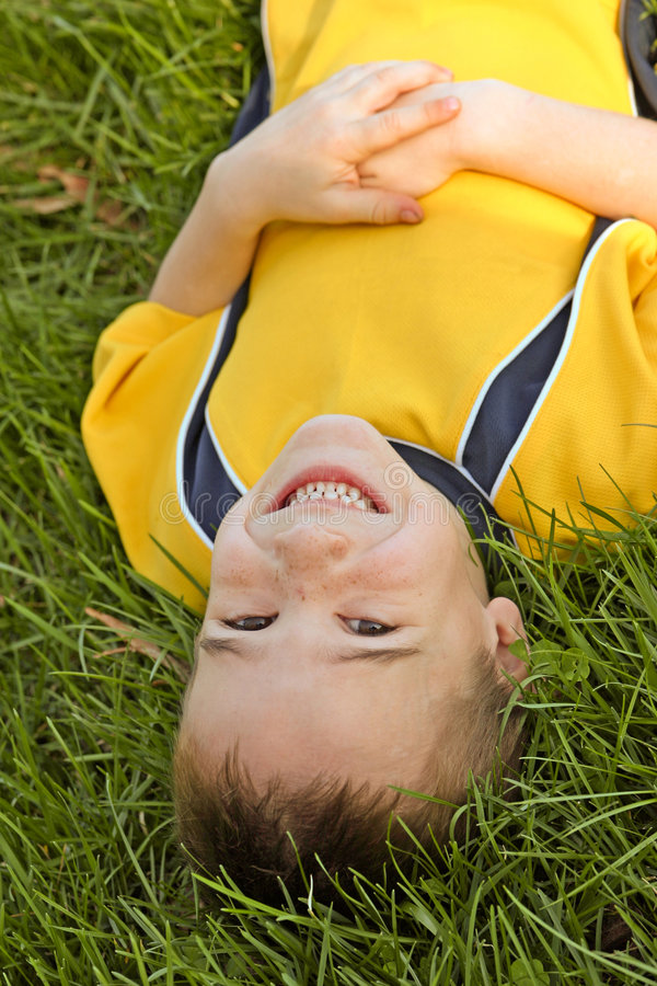 Free Boy Laying In Grass Stock Photography - 2219522