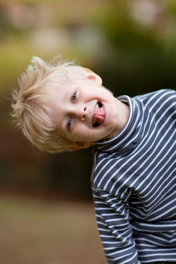 Boy leaning royalty free stock image