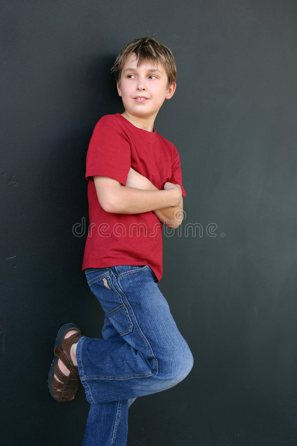 Download Boy leaning against wall stock image. Image of posture - 2578903