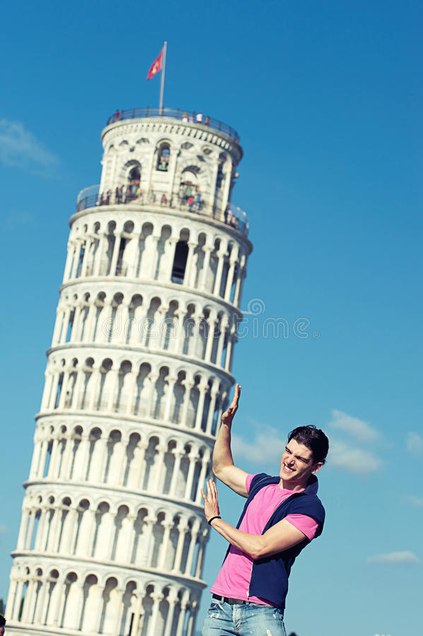 Boy with Leaning Tower of Pisa stock photos