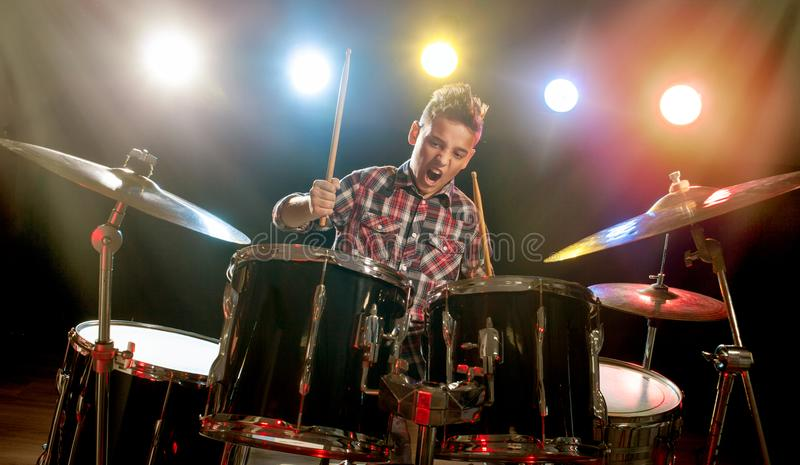 Teenage boy behind drum kit. Boy, learn to play drums stock photos