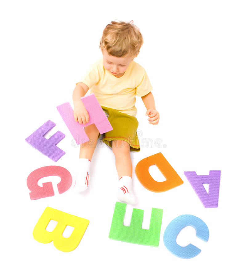 Boy learning alphabet stock photo