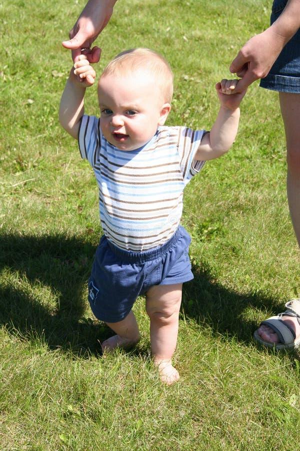 Boy learning to walk. Little boy learning to walk stock image