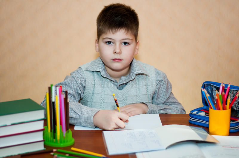 Download Boy learns at home stock photo. Image of lessons, writing - 27899610