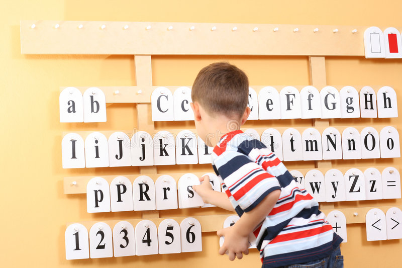 Boy and letters stock image
