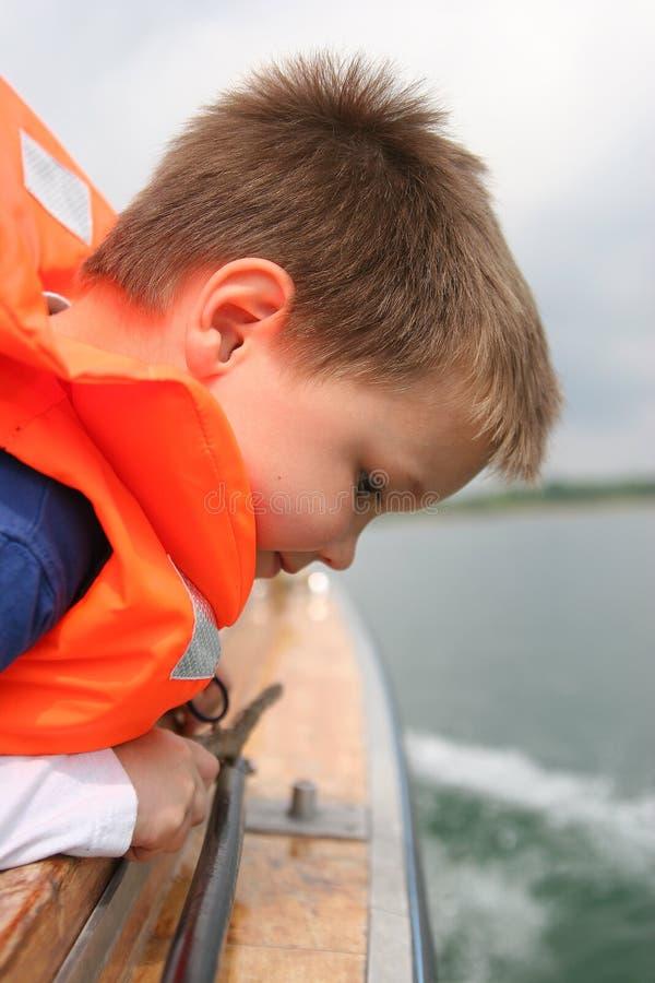Boy in life vest stock photos