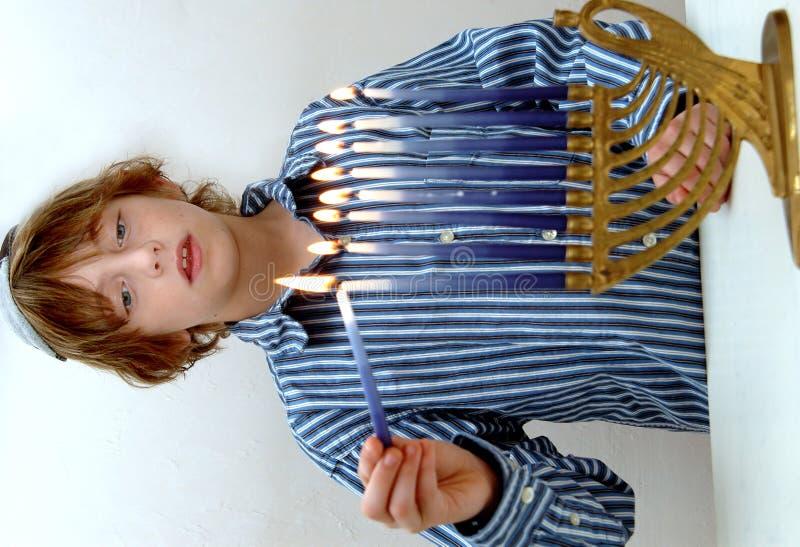 Download Boy lighting Menorah stock photo. Image of candles, decorations - 1548532