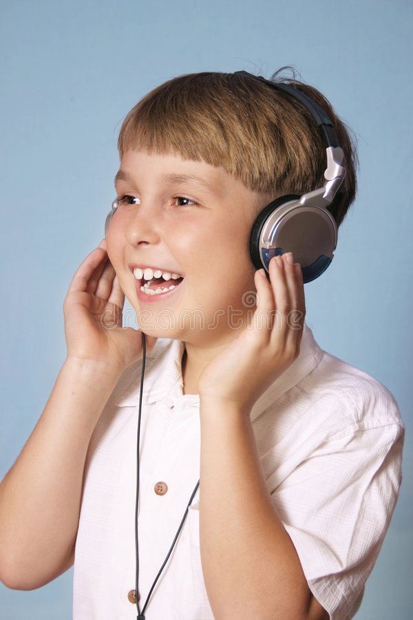 Free Boy Listening Music Stock Image - 215731