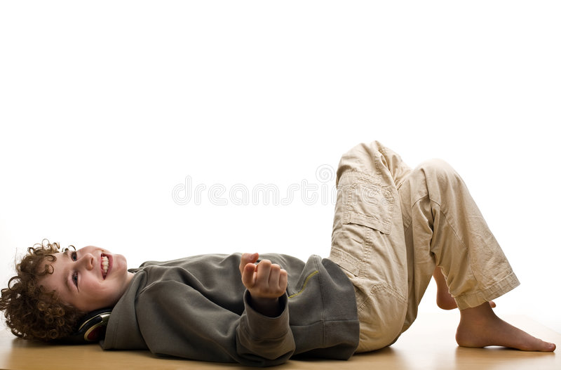Boy listening to music. Young boy listening to music royalty free stock photography