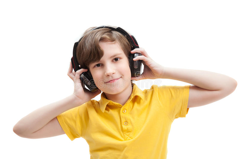 Boy listens music with headphones. Isolated on white background stock photos