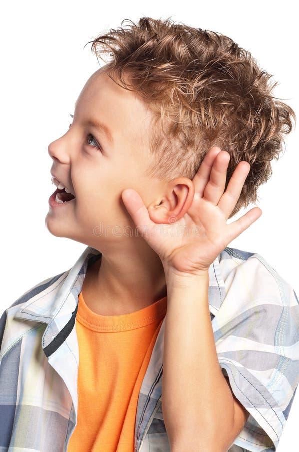 Boy listens to gossip. On white background stock image