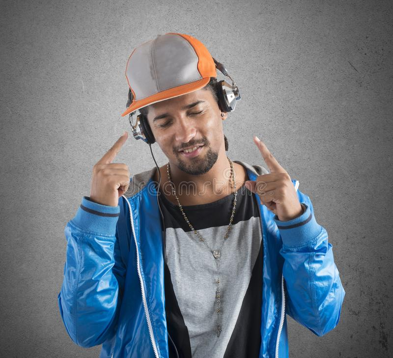 Cool boy listens music. Boy listens to music with his headphones royalty free stock photo