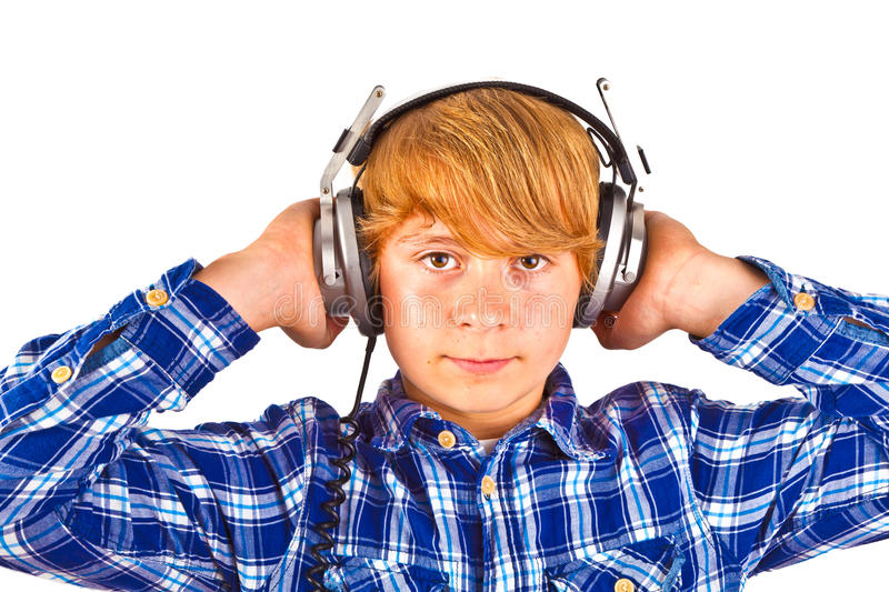 Boy listens to music with his. Teenage boy listens to music with his headphone royalty free stock photography