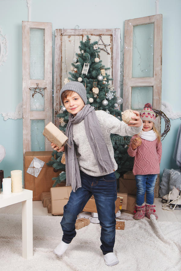 Boy and little girl new year stock photos