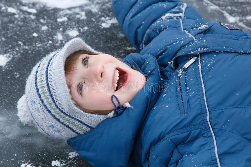 Boy little have fun winter outdoor on skating-rink. Happy smiling stock photos