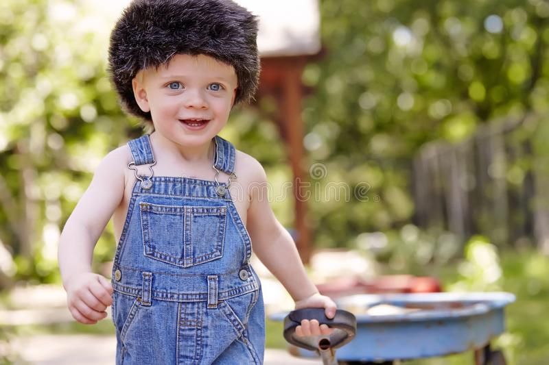 Boy. Little boy outside toy park playing cute happy sweet royalty free stock photos