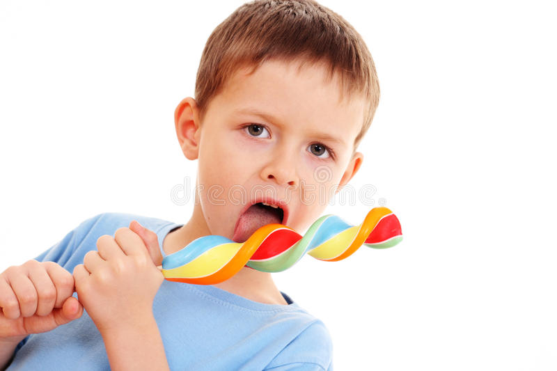 Boy with lollipop royalty free stock images