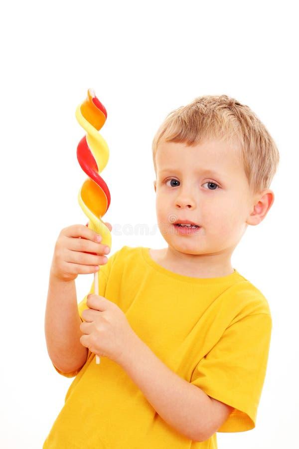 Boy with lollipop stock image