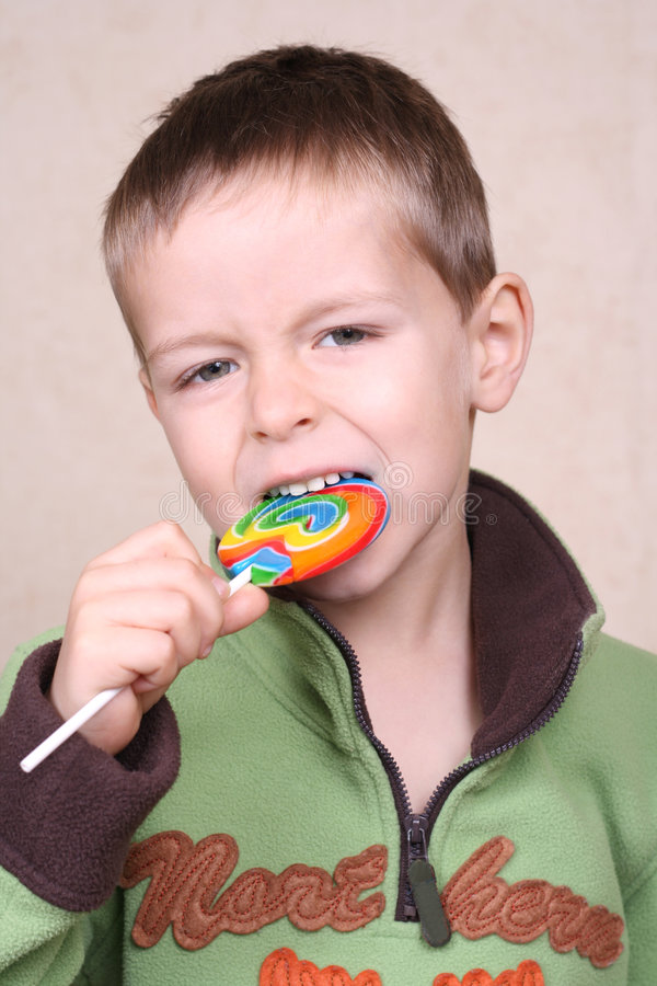 Boy and lollipop royalty free stock photos