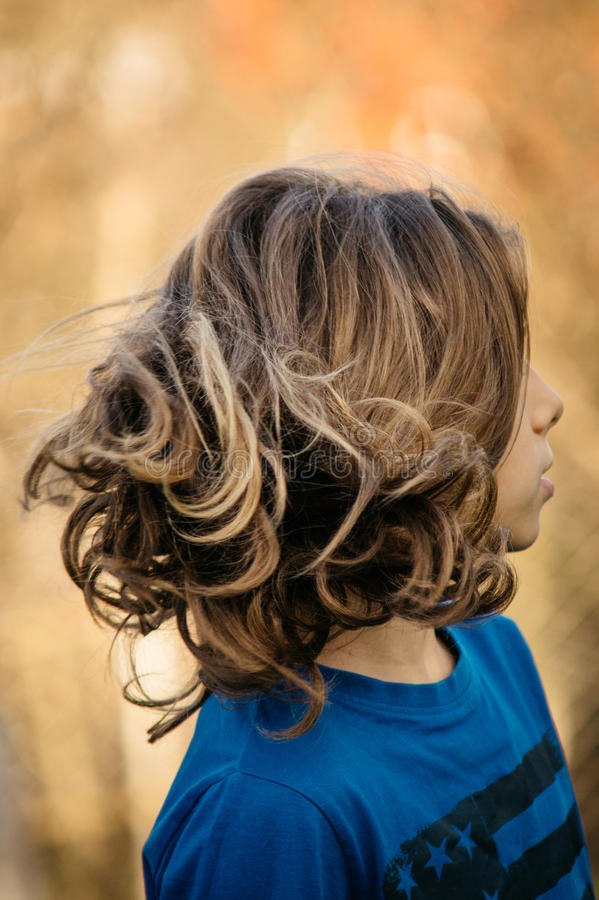 Boy with long hair. Teen boy with beautiful long hair stock photo