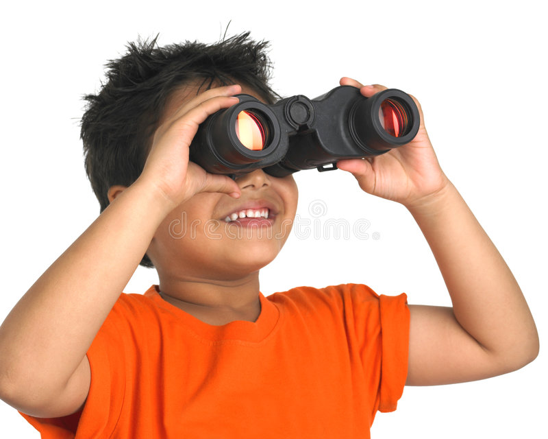 Boy looking through a binocular stock images