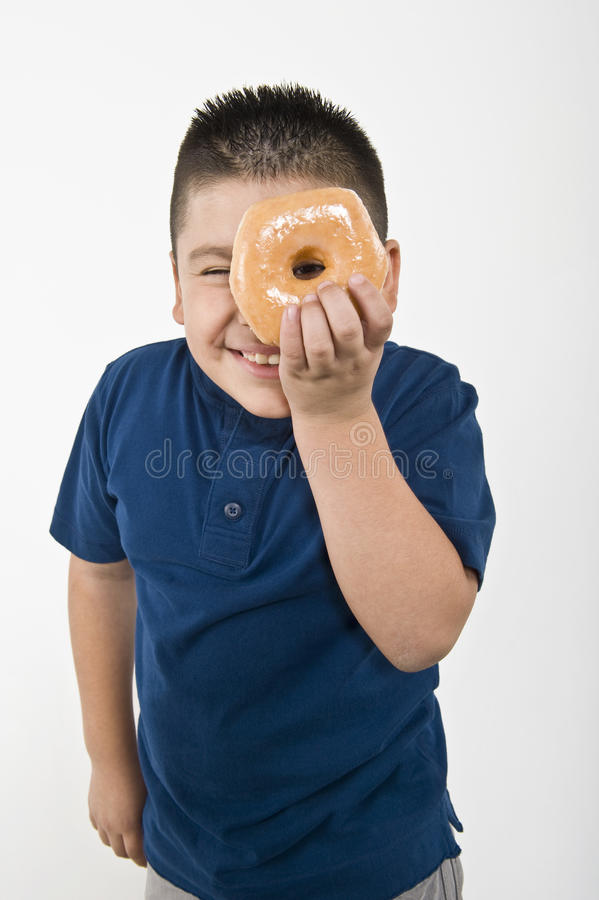 Boy Looking Through Donut stock images