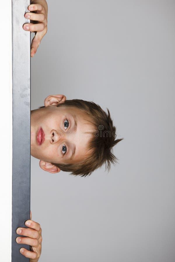 Download Boy Looking Through The Doorway Stock Image - Image: 11980217