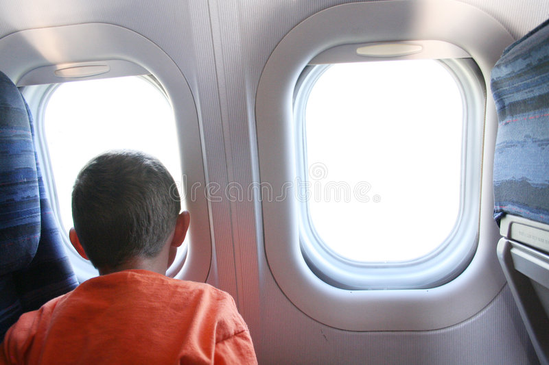Boy Looking Out Jet Window