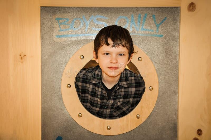 Boy Looking Through the Porthole stock images