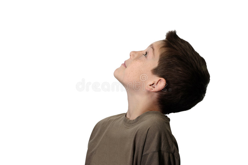 Boy Looking Up. A boy looking up. Isolated on white background royalty free stock images