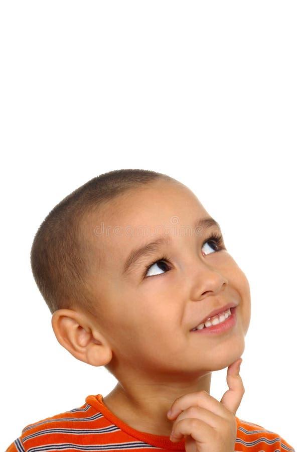 Boy looking up in wonder stock photo