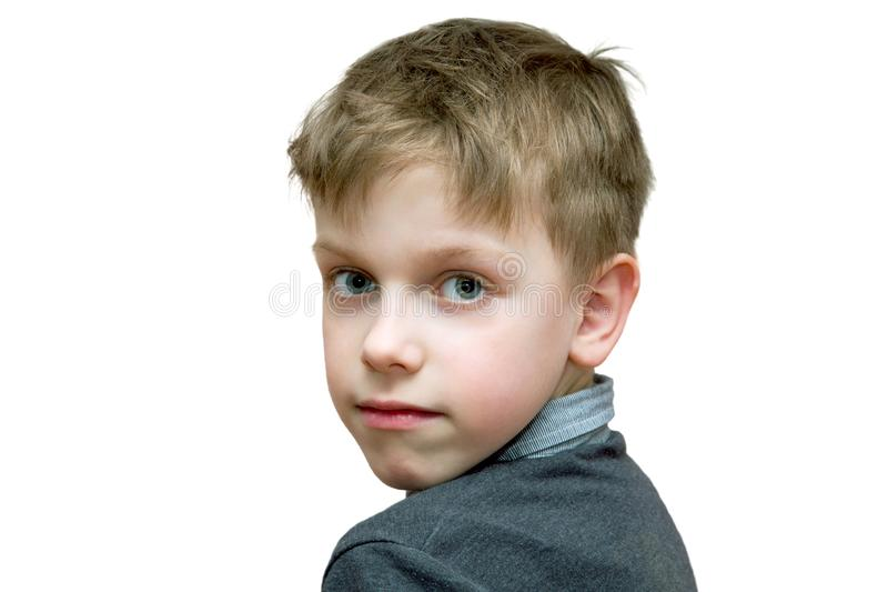 The boy looks half-turned right into the camera. On a white background stock photos