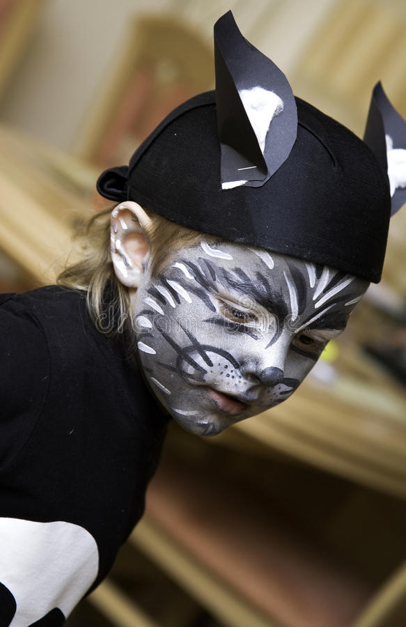 Download The Boy Makes A Children's Make-up Royalty Free Stock Image - Image: 11189356