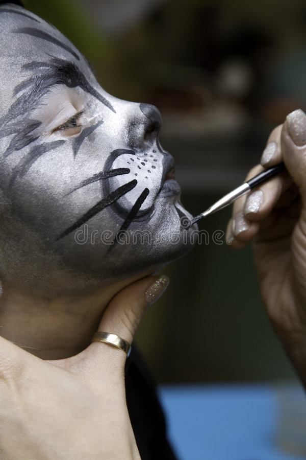 The boy makes a children's make-up royalty free stock image
