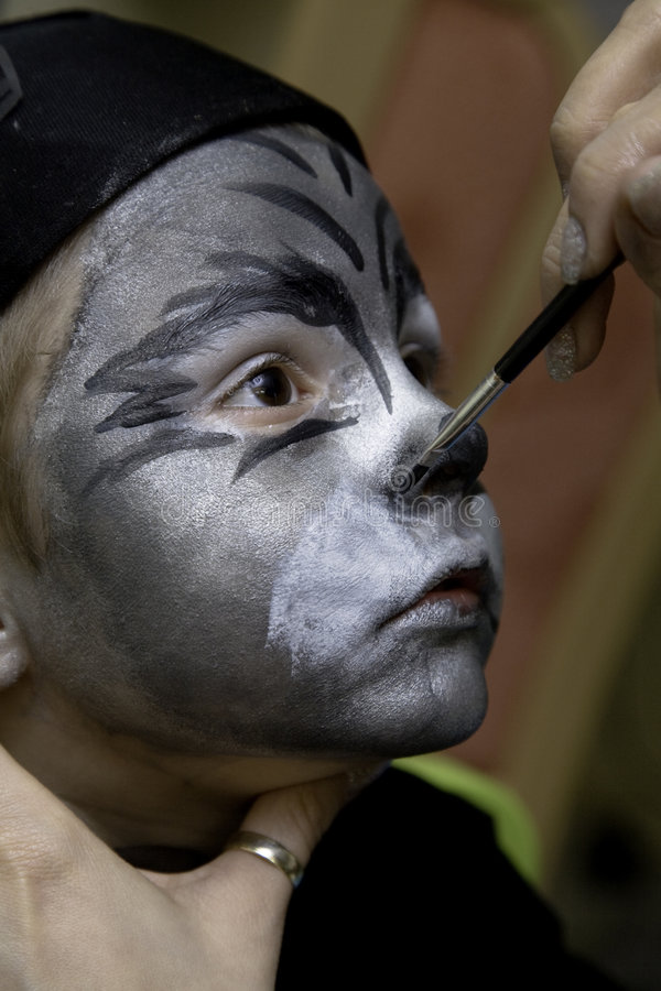 The boy makes a children's make-up stock image