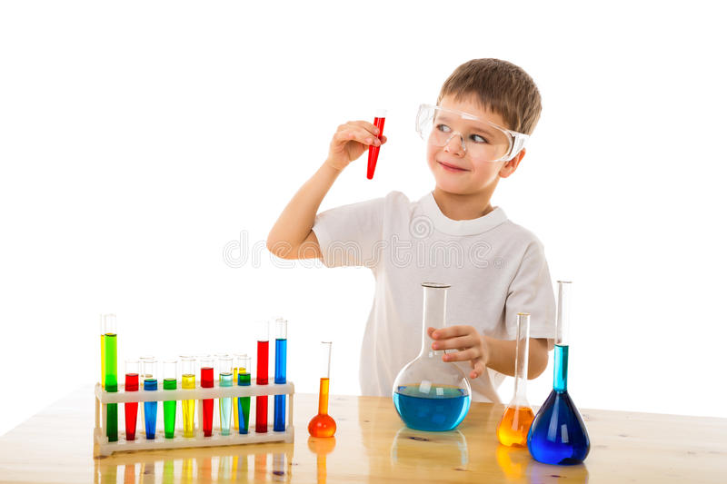 Boy making chemical experiment. Smiling boy making chemical experiment, isolated on white stock photography