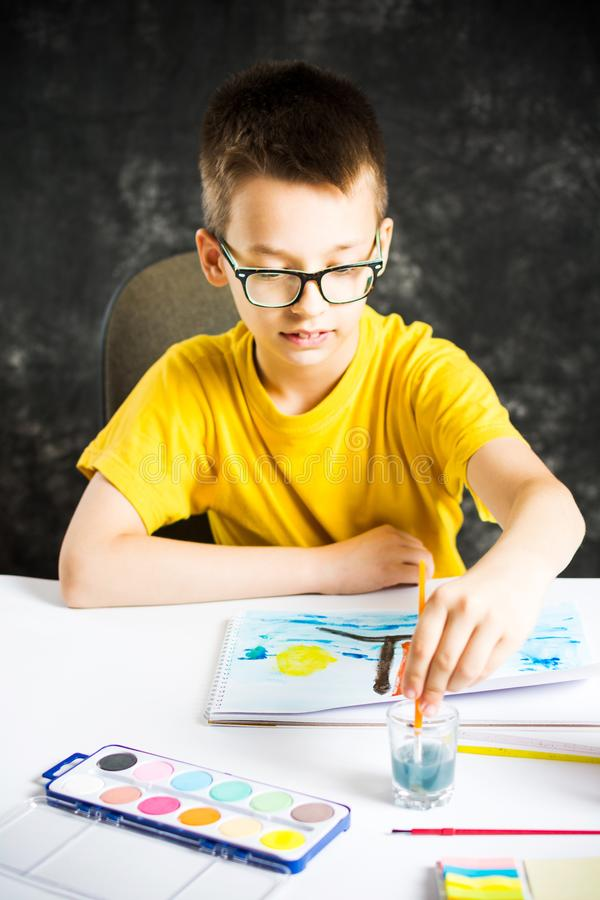 Boy making a colorful drawing at home royalty free stock photo